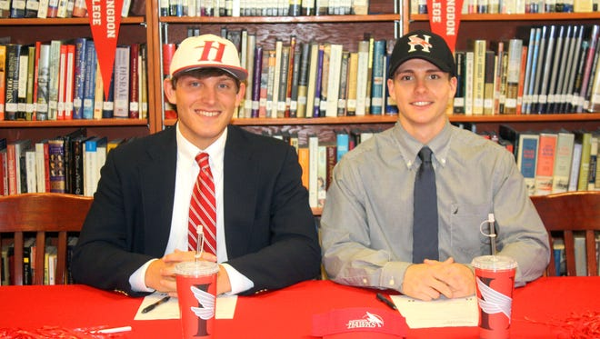 LAMP pitcher C.J. Sauce (left) and catcher Mark Dunn sign with Huntingdon College in a ceremony in the school library on Friday afternoon.