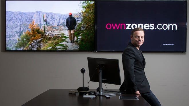 Dan Goman, CEO of OwnZones.com, launched his company in 2010 but found people were wary of being the first client. Now, 130,000 content providers partner with the company. <137>ad-free content marketplace of books, video, audio, news and entertainment media. He launched the business six months ago and has signed up 120 different content providers and several thousand subscribers. He sits in his Phoenix office on Thursday, May 22, 2014.<137>