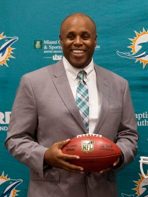 Former Dolphins director of college scouting, Chris Grier, smile as he poses for photos after Grier was introduced as the new general manager, Monday, Jan. 4, 2016 at the Dolphins training facility in Davie, Fla. Grier replaces Dennis Hickey, whose two-year tenure with the team ended Saturday on the eve of Miami's finale to yet another dismal season.