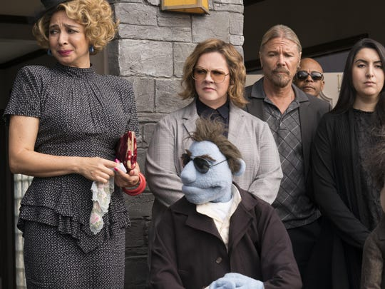 "Maya Rudolph, left, and Melissa McCarthy, background center, star in ""The Happytime Murders."" The movie is playing at Regal West Manchester Stadium 13 and R/C Hanover Movies."