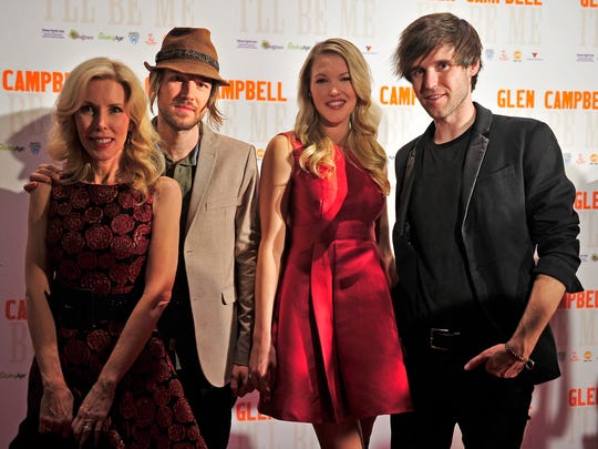 "Glen Campbell's wife, Kim Woolen, left, and his children Cal, Ashley and Shannon Campbell attend a premiere for ""Glen Campbell: I'll Be Me"" on Sunday at Music City Center."