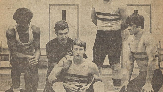 Norm Winter, Piscataway High School's coach, demonstrates a hold on Jay Stuart during a 1972 practice as teammates, from left, Dave Hough, Tony Chiarella and Rich Pirmann watch.