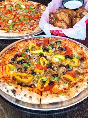 Pizza and chicken wings are pictured from 1000 Degrees Neapolitan Pizza.