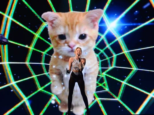 Backed by a lip-syncing cat, Miley Cyrus performs her hit single 'Wrecking Ball.'