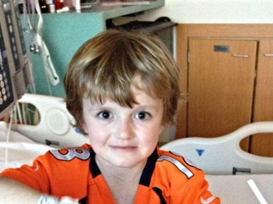 Cancer survivor Josh Hardy, 7, of Fredericksburg, Va., is pictured in his hospital room in St. Jude Children's Research Center in December, before he had a bone-marrow transplant.