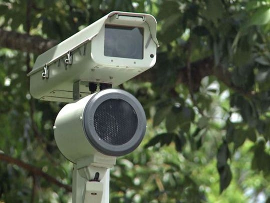 Red-light cameras like this one capture images of vehicles going through intersections once the light has turned red.