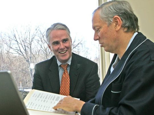 Former Gov. George Pataki, right, works in his room at Hudson Valley Hospital Center in Cortlandt in 2006 with John Cahill, his chief of staff.