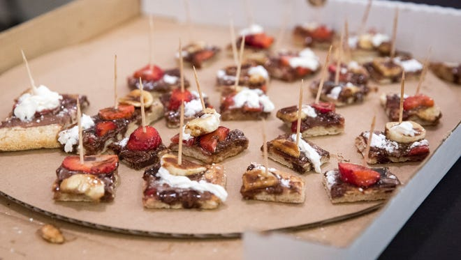 A dessert pizza is one of the options at the RP's Pizza booth on April 9 at the 31st Annual A Taste of Muncie inside Cornerstone Center for the Arts. Attendees sampled dishes from local vendors while raising money for Cornerstone's arts programs.