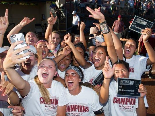 NMSU women's softball team celebrate after winning the WAC Championship Saturday 5/13/17