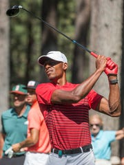 Ray Allen hits a tee shot on the fourth hole during