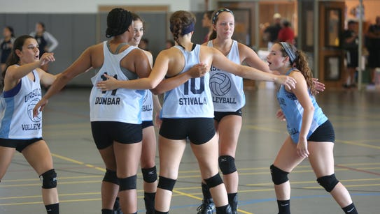 The Ursuline School celebrate a point against Ossining