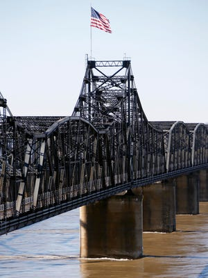 The Mississippi River rolls below the rail road bridge in Vicksburg, Miss., Wednesday, Jan. 13, 2016. Two more barges hit the bridge just after noon as the Mississippi River's high water continues to play havoc with shipping.