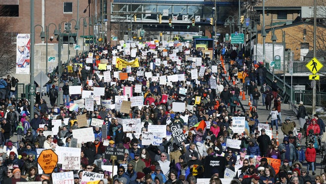 A huge crowd marches across the Court Street  bridge Saturday during the March For Our Lives.