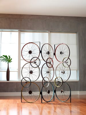 The Bicycle Collection, created by upcycling discarded bicycle rims, pedals and frames. The result are rustic yet sophisticated designs that are instantly recognizable as repurposed. The Bicycle Screen is made from three panels that are hinged together, allowing for many configurations.