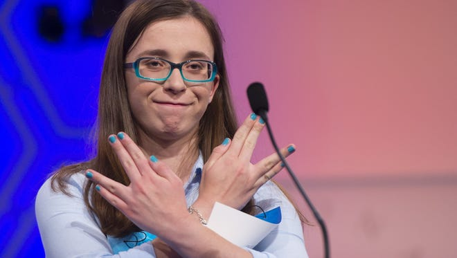 """Madeline Rickert of Minot, North Dakota, reacts after correctly spelling her word, """"telamon,"""" during the 3rd round of the 88th Annual Scripps National Spelling Bee at National Harbor in Oxon Hill, Maryland, May 27, 2015."""