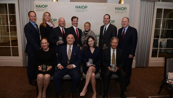 Pictured from left to right in back at NAIOP NJ's 2016 President's Awards and Hall of Fame dinner are President Clark Machemer of the Rockefeller Group, Kim Brennan, Colliers International; Jeffrey Greif, First American Title Insurance; Bill Hanson, NAI James E. Hanson; Seena Stein, Newmark Grubb Knight Frank; Terrence Huettl, Whitesell Construction, and Eugene Preston, Dermody Properties. Pictured in front from left to right are Ellen McNamara, widow of posthumous winner Joseph McNamara, New Jersey Laborers' Employers Cooperation and Education Trust; Charlie Klatskin, Forsgate Industrial Partners; Kelsey Nakamura, Cushman & Wakefield, and Allen Magrini, Hartz Mountain Industries.