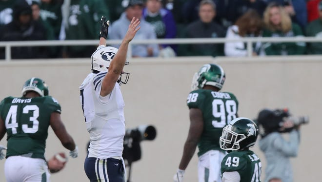 BYU's Taysom Hill celebrates after a touchdown against MSU on Oct. 8, 2016.