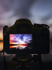 Camera capturing sunset.