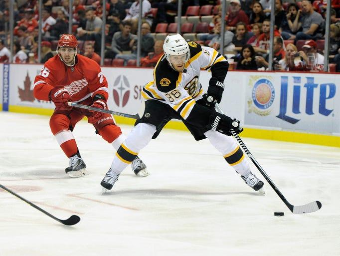 Boston Bruins defenseman Kevan Miller (86) skates against
