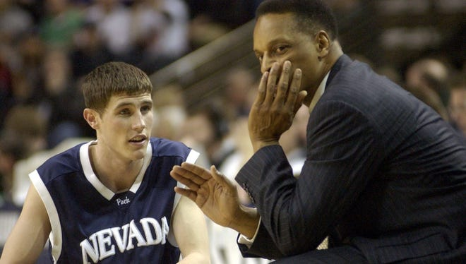 Wolf Pack coach Trent Johnson talks to Todd Okeson in the final moments of their 2004 NCAA Tournament win over Michigan State.