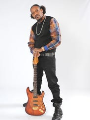 Guitarist Eric Gales cranks up the tunes on Sunday