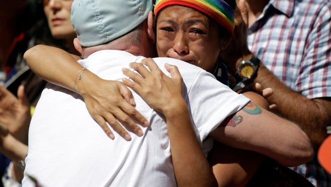 Cecilia Chen, at right, is consoled by a marcher as she cries during the San Francisco Gay Pride parade Sunday, June 26, 2016, in San Francisco.  (AP Photo/Marcio Jose Sanchez)