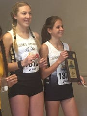 Oak Park's Sylvia Cruz-Albrecht, right, and Sarah Shulze placed 1-2 in the Division 3 girls final at the CIF-SS Cross Country Championships on Saturday in Riverside.