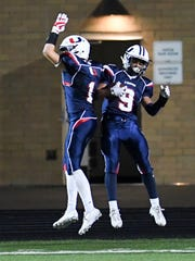 Urbandale Receiver Chris Miller (9) celebrates a touchdown with teammate J.D. Colby (1) on Friday, Oct. 6, 2017, during a football game between the Urbandale J-Hawks and Council Bluffs Thomas Jefferson at Urbandale High School.