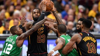 May 21, 2018; Cleveland, OH, USA; Cleveland Cavaliers forward LeBron James (23) attempts a layup against Boston Celtics guard Terry Rozier (12) and guard Marcus Smart (36) during the third quarter in game four of the Eastern conference finals of the 2018 NBA Playoffs at Quicken Loans Arena. Mandatory Credit: Ken Blaze-USA TODAY Sports