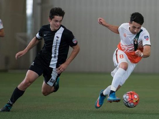 Bucks player Adam Najem (right) races by a Pittsburgh