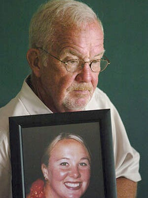 Richmond High School graduate Carl Flatley holds a picture of his daughter, Erin, who died from sepsis in 2002. Flatley founded the Sepsis Alliance to raise awareness of the disease, and is one of four finalists for the NASCAR Foundation's humanitarian award.