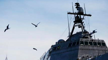 "In November photo, birds fly by the USS Gabrielle Giffords, a Naval littoral combat ship built at the Austal USA shipyards, docked on the Mobile River in Mobile, Ala. The ship is named in honor of former U.S. Rep. Gabrielle ""Gabby"" Giffords of Arizona. Giffords, the former Arizona congresswoman who was shot in the head during an assassination attempt in 2011, helped christen the ship in 2015. It's part of a hotly debated program that congressional critics slam as flawed and too expensive but that Navy leaders defend as a critical new step in naval warfighting."