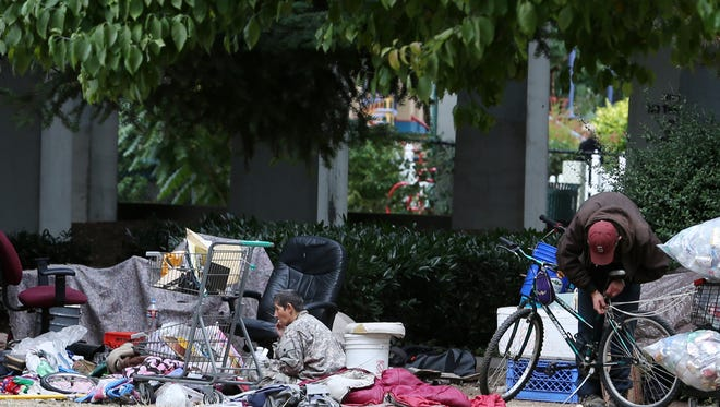 A makeshift homeless camp is set up near the bridge on Tuesday, Aug. 30, 2016, at Marion Square Park in downtown Salem.