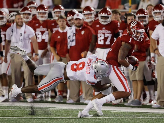 Indiana's Simmie Cobbs Jr. (1) is tackled by Ohio State cornerback Kendall Sheffield during the first half of an NCAA college football game Thursday, Aug. 31, 2017, in Bloomington, Ind. (AP Photo/Darron Cummings)