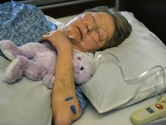 Jody Wooton lies in her bed at Kansas City Hospice House on the morning of February 12.