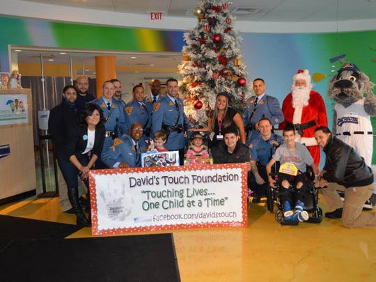 Last year's David's Touch toy drive with some of the volunteers.
