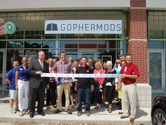 gm ribbon cutting.jpg