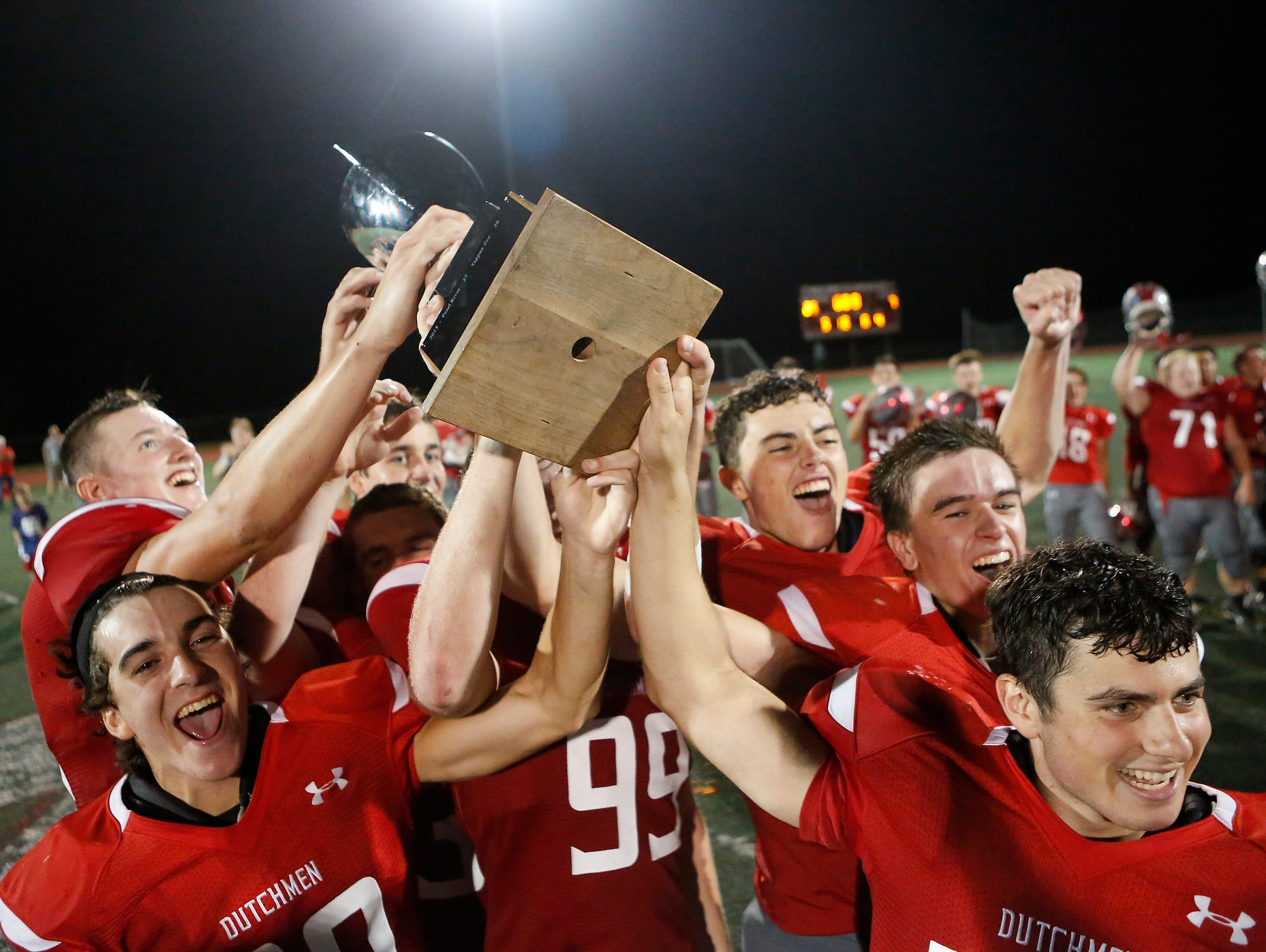 Tappan Zee players hoist the Orange Bowl trophy after their 25-7 win over Pearl River at Tappan Zee High School in Orangeburg on Friday, September 23, 2016.