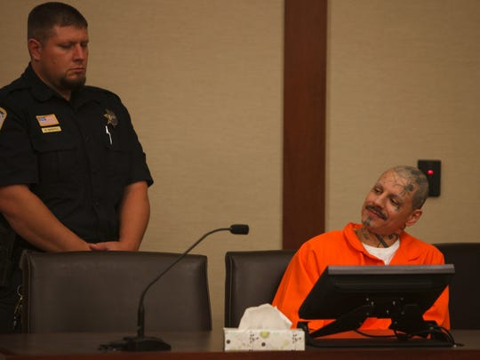 Mario Antoine Lucero smiles as his sister testifies against him during Lucero's preliminary hearing on charges of first-degree felony murder and third-degree felony assault in 5th District Court Thursday, Sep. 18, 2014.