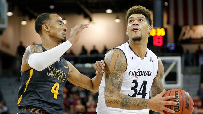 Cincinnati Bearcats guard Jarron Cumberland (34) drives against Coppin State Eagles guard Tre' Thomas (4) in the first half of the NCAA men's basketball game between the Cincinnati Bearcats and the Coppin State Eagles at BB&T Arena in Highland Heights, Ky., on Thursday, Nov. 16, 2017. At halftime the Bearcats led 55-26.