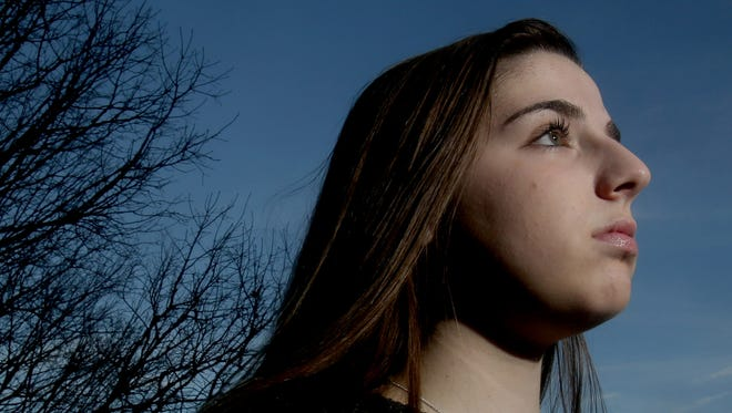 Angela McDevitt, 17, a student at Arlington High School, is being credited with thwarting a possible mass school shooting. McDevitt, photographed Feb. 20, 2018, received text messages from Jack Sawyer, who she had met while both were residents in a Maine treatment center for youths with emotional problems. The text messages she received from Sawyer described his desire to conduct a mass shooting at his old high school in Vermont. McDevitt brought the texts to the attention of authorities, and Sawyer was arrested before he could carry out a shooting.