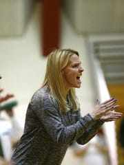 Green Bay Notre Dame head coach Sara Rohde cheers during
