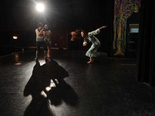 Goeun Kim and Hsiao-yin Peng record Ana Parra as she dances on stage at The Palace Theatre in Cape Charles, Va. on Thursday, July 9, 2015. Several filmmakers were in town for the week-long Experimental Film Virginia.