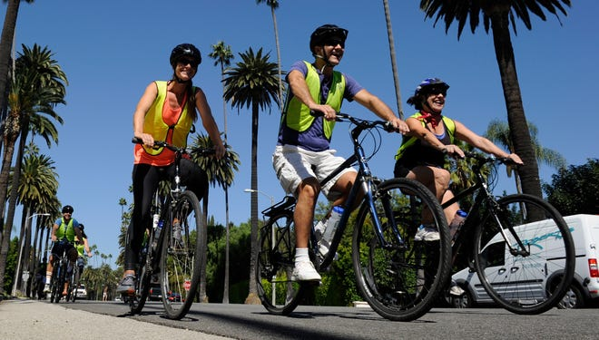 Maria Bager, Ethan Flower and Tracy Patton ride down Beverly Boulevard in Beverly Hills with a group from Bikes and Hikes L.A.The company offers several tours of Los Angeles, stretching from Griffith Park to Santa Monica.