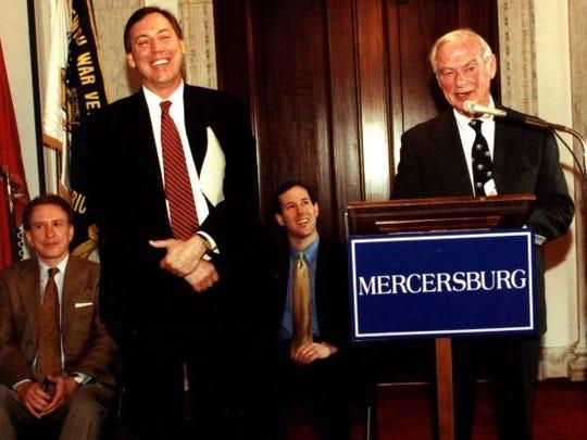 Gerry Lenfest in 2000 speaks with Douglas Hale, head of The Mercersburg Academy. Seated are Pennsylvania's then U.S. senators Arlen Specter (left) and Rick Santorum.