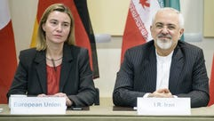 Iranian Foreign Minister Javad Zarif, right, and European