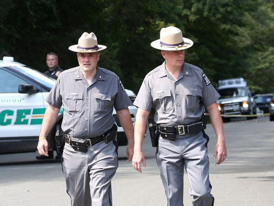 New York State troopers work near the scene of an apparent