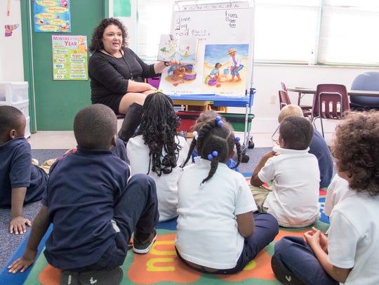 Kindergarden teacher Michelle Andersen reads to her