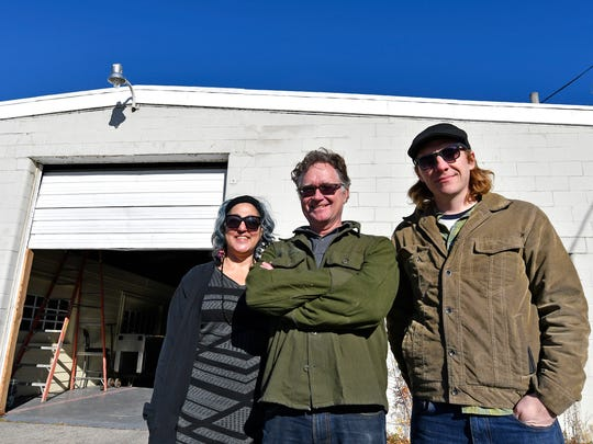 From left, Tamina Karem, Scott Boyer, and Matt Weir stand in front of the building slated to become their new Falls Art Foundry, at 1715 Portland Ave., Thursday, Dec. 08, 2016 in Louisville KY.