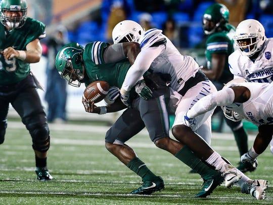 University of Memphis defender Christian Johnson (right)
